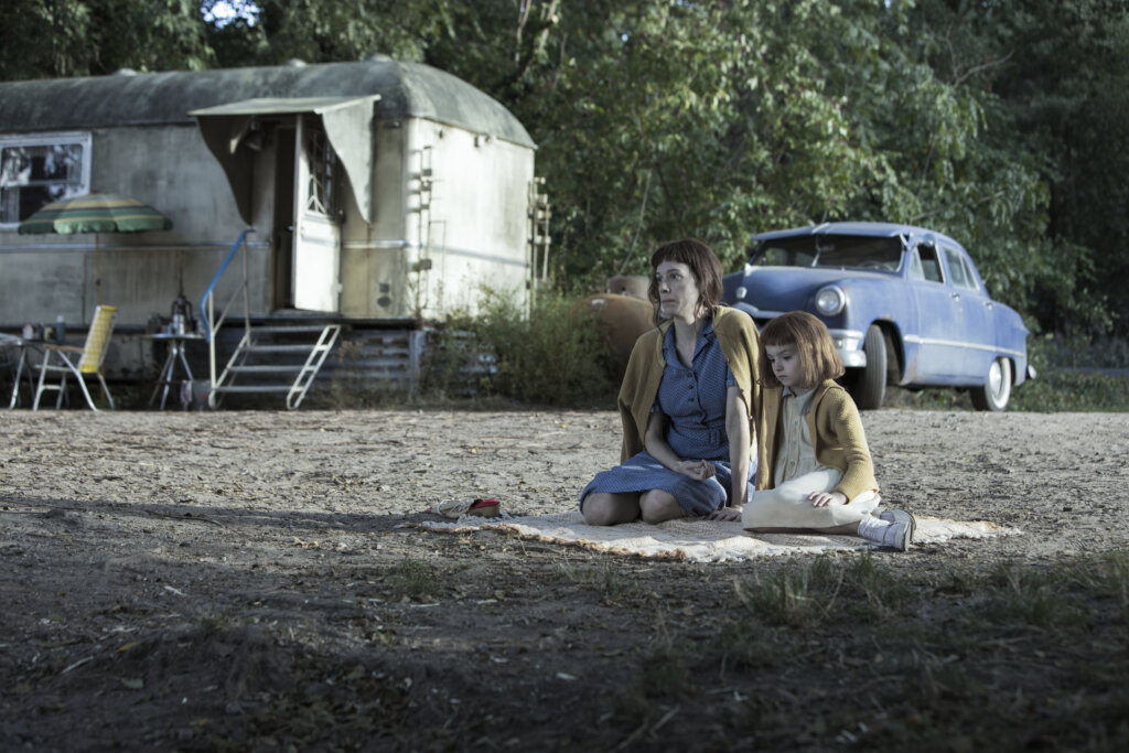 Beth and her mom outside mobile home