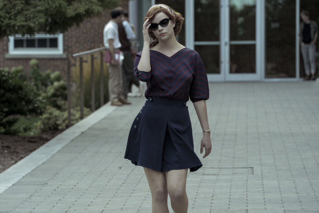 Beth walks outside college